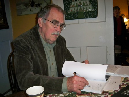 Andrew L. Phelan signing copies of his book Becoming the Village Potter in December 2012.
